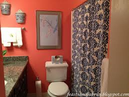 Coral Bathroom with blue patterned shower curtain: Feasts and Fabrics