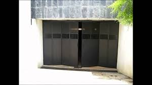 folding garage doorsQuality Automations  Folding Garage Door  YouTube