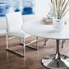tulip pedestal round dining table polished nickel base