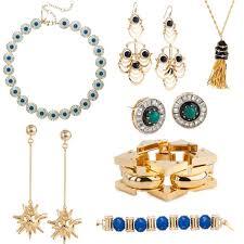 clockwise from top right sundial necklace 395 chandelier earrings 250 constellation tassel necklace 180 sundial earrings 170 satellite bracelet