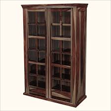 unique wood storage cabinets with glass door with tall locking storage cabinet and wall