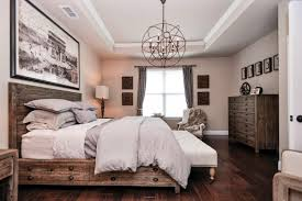 traditional master bedroom with crown molding chandelier in