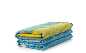 ekko throw blanket yellowdusty blue – a wool throw with a graphic
