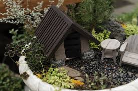 view full sizefaith cathcart the oregonianblack pebbles wooden furniture and a dark roofed structure are part of a mountain themed grouping
