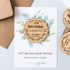 rustic wooden magnet save the dates by letter folk studio