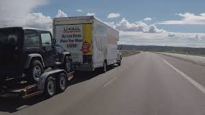 Driver Viewpoint U Haul Moving Truck Towing Car Passing Stock Video Footage - Storyblocks Video