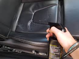 next working one leather panel at a time i applied cleaner directly to the seats then used a soft bristled shoe polishing brush under light pressure