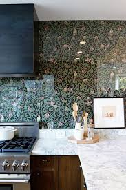 tile backsplash may be too often we see but the wallpaper backsplash is a unique way of decorating your kitchen