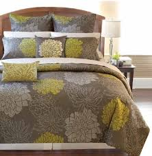 yellow and brown lotus pattern bedding with rustic wooden