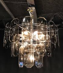 amber crystal octagons etched with stars circle to create this special two tiered chandelier