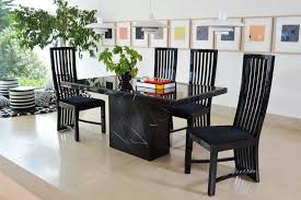 a thin marble dining table top with chrome steel and leatherette base that has white stones looks posh and high end with matching chairs