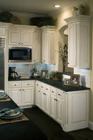 Love The Distressed Look Of These Cabinets Cabinets Dark