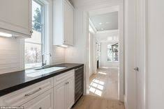 expansive the kitchen and laundry rooms run straight through to the bright and beautiful living