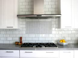 stainless steel built in kitchen with gray countertops