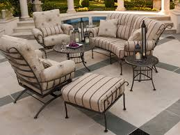 black iron outdoor furniture. Black Wrought Iron Patio Furniture With Cream Cushion Chairs And Very Small Round Table Outdoor
