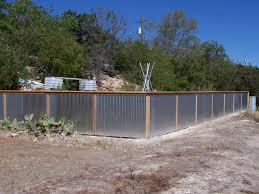 image of corrugated metal fence install
