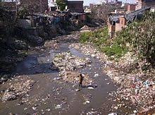 environmental issues in  solid waste adds to water pollution in a 2005 image