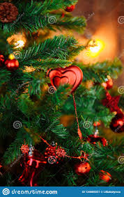 Christmas Tree Decorated With Red Toys Ornaments Pine
