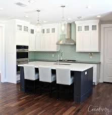 cabinet color is decorator s white and island is wrought iron both benjamin moore