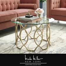 gold medium round glass coffee table