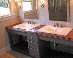 white painted wooden vanity combined black marble counter top