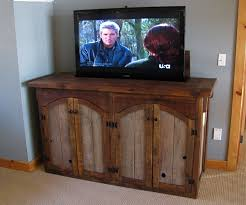 tv hideaway furniture. Excellent Motorized Tv Lift Cabinet For Entertainment Room Ideas: Grey Accent Wall Design With Wood Hideaway Furniture
