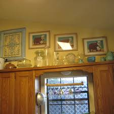 best decorating ideas above kitchen cabinets images