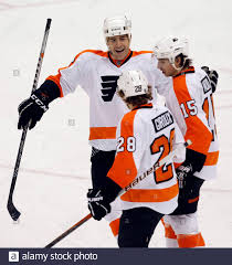 Philadelphia Flyers' Sean O'Donnell (L) and Andreas Nodl (15) congratulate  teammate Claude Giroux (28) on his goal against the Pittsburgh Penguins in  the second period of their NHL hockey game in Pittsburgh,