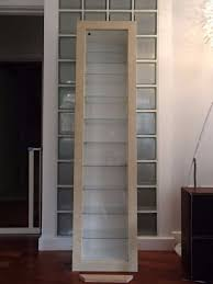 ikea bertby wall mounted glass fronted display cabinet