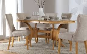 townhouse extending dining table with 4 bewley oatmeal chairs in pedestal round white