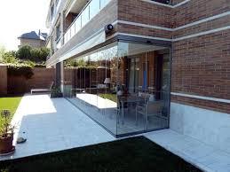 sliding glass walls for porches gardens