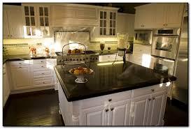 black kitchen cabinets and granite countertops photo 14