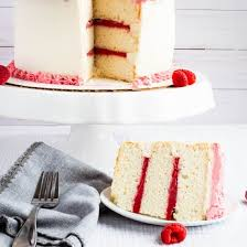 White Almond Cake With Raspberry Filling And Buttercream Frosting