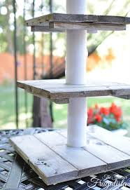 bottom layers of diy rustic wooden wedding cupcake stand