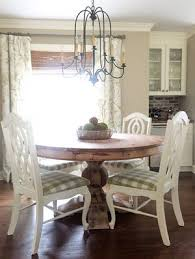 breakfast room dining built in bar round pedestal table with vine chairs farmhouse chandelier beth hart designs