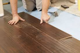 14202735 man installing new laminate wood flooring abstract