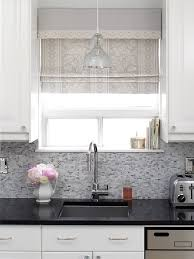 charming kitchen with absolute black granite counter tops mosaic tiles backsplash ivory white custom roman shade jamie young st