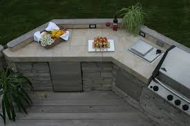 rustic wooden floor with beige ceramic countertop for amazing outdoor kitchen ideas with modern appliances