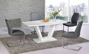 white glass dining table and 6 grey chairs with high gloss base