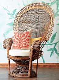 This wicker peacock chair is made of woven rattan in a natural honey hue  that projects