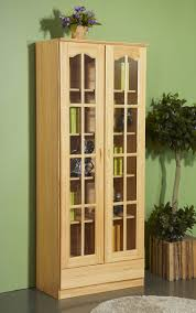natural polish bookcase with glass doors added with light grey carpet on grey ceramic