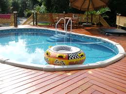 home swimming pools above ground. Above Ground Pool Decks Idea For Your Backyard Decor: Tropical Patio And Alluring Home Swimming Pools U