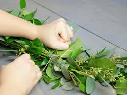 turn last greenery bunch the opposite direction and hide stems by tucking into the leaves of previous bunch wrap with paddle wire then cut and tie wire