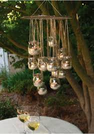 outdoor backyard lighting ideas. outdoor hanging tealight candle chandelier backyard lighting ideas