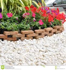 garden decoration. Garden Decoration With White Rock And Flowers