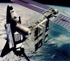 Image result for The space shuttle Atlantis, bottom, is docked to the Russian space station Mir 245 miles above Earth in this image from NASA television