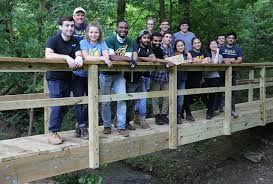 engineers for international development designed and built a bridge for hikers in toms creek virginia this summer the group does one international