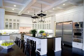 kitchens with white cabinets and dark floors. Eat In Kitchen A Spanish Revival Home With Two Lantern Lights, White Cabinets Glass Fronts, Coffered Ceiling, Stainless Appliances And Kitchens Dark Floors D