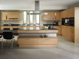 s white paint for wall kitchen decors with euro stainless steel ceiling chimney hood over island and natural hardwood modern kitchen cabinets designs