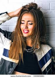 fashion portrait of y stunning hipster woman bright make up vine sungles biker